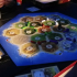 Catan Seafarers expansion pack pieces with a piece holder image