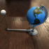 Globe model with stand and orbiting Moon image
