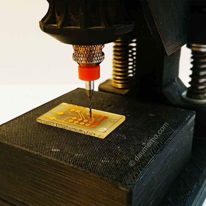 A desk drill press for a rotary tool (Dremel-like)