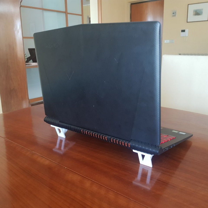 Integrated laptop riser/stand