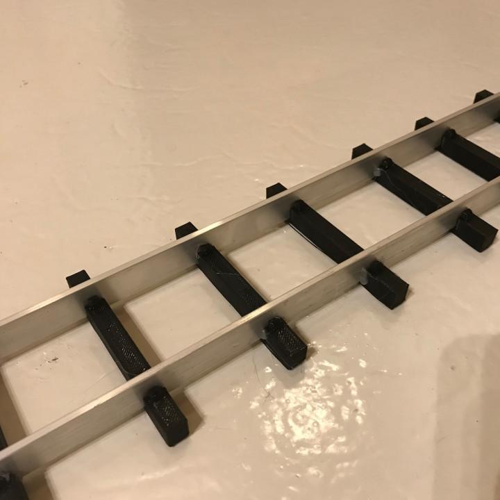 Sleepers for aluminium or wood rails