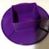 Anti-spil plate for a flux bottle image