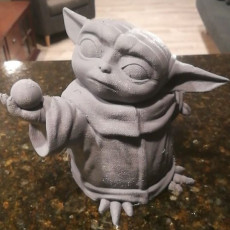 Picture of print of baby yoda with ball