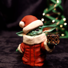 Picture of print of Santa Hat Baby Yoda with Holocron
