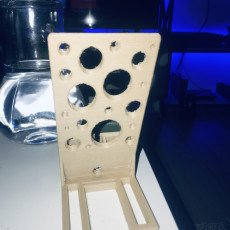 Picture of print of phone holder/stand with charge cable