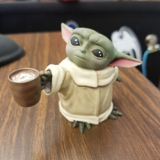 Baby Yoda with coffee cup