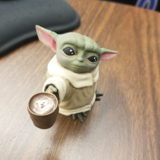 Picture of print of Baby Yoda with coffee cup