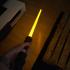 Rey's yellow Lightsaber Star Wars image