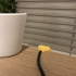 Mouse cable desk clip image