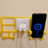 Phone stand for power outlet image